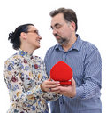 Mature man giving his wife a gift Royalty Free Stock Image