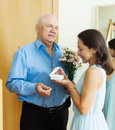 Mature man giving jewel in box to woman men women at home door Royalty Free Stock Photos