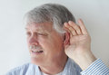 Mature man has trouble hearing Royalty Free Stock Photo