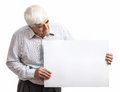 Mature man holding a blank billboard over white isolated on background Royalty Free Stock Photo