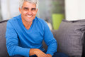 Mature man home smiling relaxing at Royalty Free Stock Images