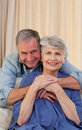 Mature man hugging his wife Stock Photography