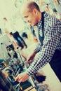 Mature man making duplicates of keys Royalty Free Stock Photo