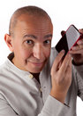 Mature man with phone Stock Image