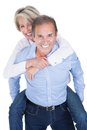 Mature man piggybacking his wife happy over white background Royalty Free Stock Image