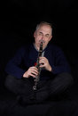Mature man playing the clarinet Royalty Free Stock Photo