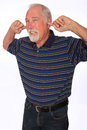 Mature man plugging his ears noise is too loud for this Stock Photography