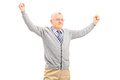 Mature man raising his hands out of joy isolated on white background Royalty Free Stock Images