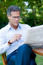 Mature man reading news Stock Photo