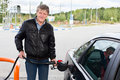 Mature man refueling car with gasoline in Royalty Free Stock Image