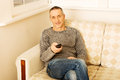 Mature man with remote control Royalty Free Stock Photo
