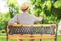 Mature man resting on a bench in park Stockbilder
