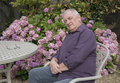Mature man sitting in the garden Royalty Free Stock Photo
