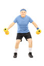 Mature man in sportswear exercising with dumbbells full length portrait of a isolated on white background Royalty Free Stock Image