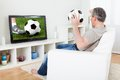 Mature man watching football on television Royalty Free Stock Photo