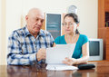 Mature man with wife reading documents serious men financial Royalty Free Stock Images