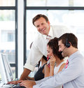 Mature manager in a call center smiling at the cam Stock Photo