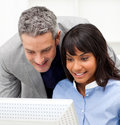 Mature Manager checking his employee's work Stock Photos