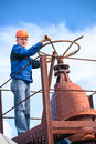 Mature manual worker turning huge valve gate Royalty Free Stock Photo