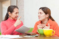 Mature mother berates adult daughter for utility payments bills or credits Royalty Free Stock Photos
