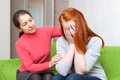 Mature mother comforts crying daughter Stock Photo