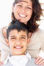 Mature mother and son giving warm smile Stock Photos