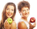Mature mother and yung daughter with apples isolated on white Royalty Free Stock Image