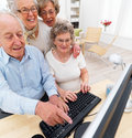 Mature people working at home on computer Stock Images