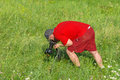 Mature photographer taking a photo of wild nature hard bend Stock Photos