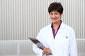 Mature professional woman dressed in labcoat Royalty Free Stock Photo