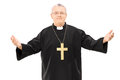 Mature reverend in black mantle with open hands isolated on white background Stock Image