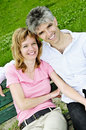 Mature romantic couple on a bench Royalty Free Stock Images