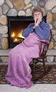 Mature Senior Woman Rocking Chair Fireplace Gossip Royalty Free Stock Images