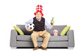 Mature sport fan holding a ball and beer watching sport with hat soccer isolated on white background Stock Photo