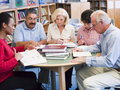 Mature students studying in a library Royalty Free Stock Photo