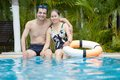 Mature swimmers couple embracing in the pool Royalty Free Stock Images
