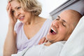 Mature unhappy girlfriend cannot stand guy snoring loudly Royalty Free Stock Photo
