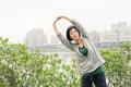Mature woman of asian stretch her body in outdoor park Stock Images