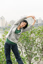 Mature woman of asian stretch her body in outdoor park Royalty Free Stock Images