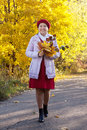Mature woman in autumn with maple posy Stock Images