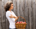 Mature woman with basket of apples Royalty Free Stock Photo