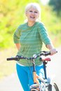 Mature woman with bicycle Stock Photography