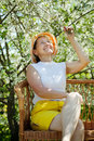 Mature woman  in bloom garden Royalty Free Stock Photography