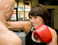 Mature Woman with Boxing Dummy Royalty Free Stock Photography
