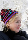 Mature woman bundled up in snow Royalty Free Stock Image