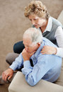 Mature woman comforting senior man Royalty Free Stock Image