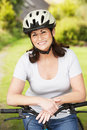 Mature woman on cycle ride in countryside smiling to camera Royalty Free Stock Photos
