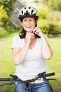 Mature woman on cycle ride in countryside smiling to camera Royalty Free Stock Images