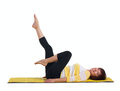 Mature woman doing gymnastics exercise in the lying position on the back isolated on white Royalty Free Stock Photography