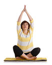 Mature woman doing yoga exercise sitting on yellow matting isolated on white Stock Images
